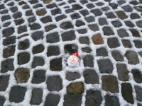Snow and Santa on paving stones