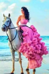 Beautiful Young Woman on a White Horse