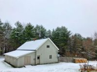 barn_winter_snow_woodpile_land_view-768x576