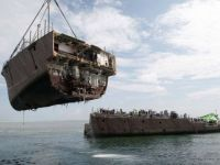 "Mine counter measure ship ""Guardian"" being salvaged"