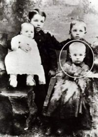 Who is the little boy circled?