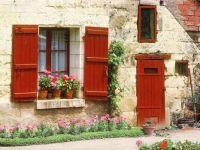 Red Window Shutters And Door