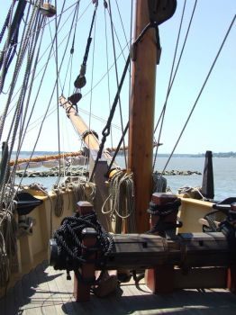 Standing at the wheel of an exact reconstruction of one of the ships to arrive at Jamestown Va