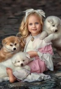 A girl and her puppies