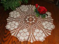 crocheted doily with rose