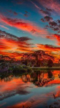 Reddish clouds on beautiful lake