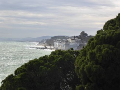 Spain. Looking along the coast to the small town of Calella, on a stormy day