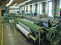C7 - Rolls of woven cloth being prepared for next step, Amana Colonies, Iowa, July 2016.
