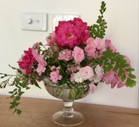 Fairy roses and carpet roses And maidenHair fern.compose this beautiful arrangement