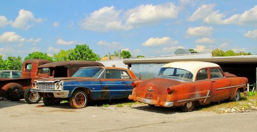four old cars waiting to be restored