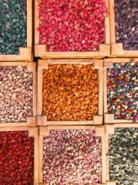 top-view-of-assorted-colored-stones-in-wooden-containers-2734616