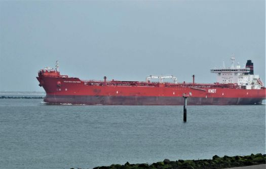 If a ship is painted red, it means it has oil, gas or chemicals aboard (dangerous! explosion danger!) This one is empty and lying high on the water.