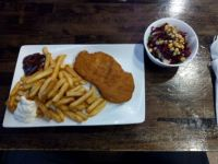 schnitzel with fries and salad