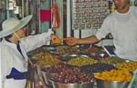 A66 Sampling some olives and peppers, in sook in Rehovot, Israel, 1994 trip