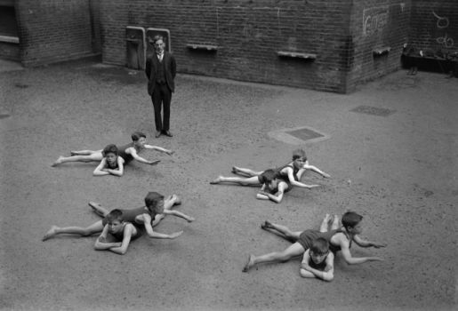 Children without access to water learn to swim in a schoolyard. 1922