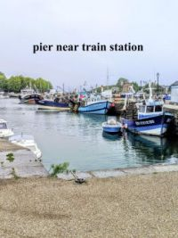 The train station for the petite train in Honfleur started near a waterfront pier, 2019