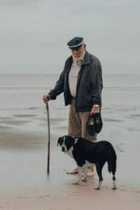 old man and dog by the sea
