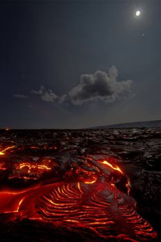 Lava flows under a starry sky