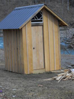Our new outhouse. Only my DH would rebuild it. He worked on it all winter.