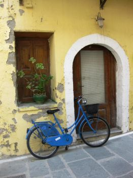 Blue bicycle leaning on wall