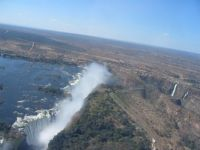 the big crack in the earth that forms Victoria Falls (note the road for scale)