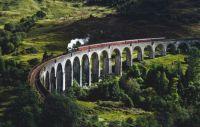 Steam train crossing Glenfinnan Viaduct, Scotland