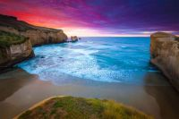 sunrise-over-tunnels-beach-new-zealand