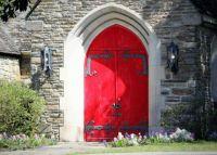 Red church door in UK