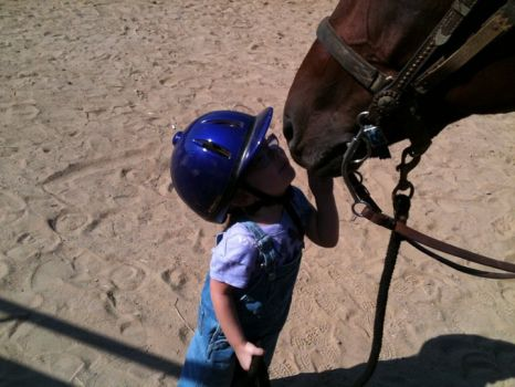 5 yr old Grand Daughter at her riding lesson.