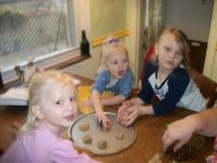 Hayven, Lily, and Gracie doing Christmas cookies