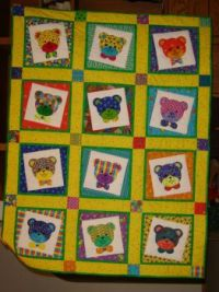 Appliqued crib quilt for my grandaughter