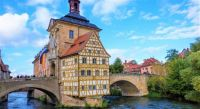 Bridge over Rednitz river and Old town hall (Altes Rathaus) in Bamberg, Germany