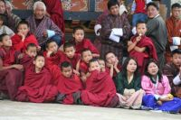 Young monks enthralled by Monk Dancing, Bhutan