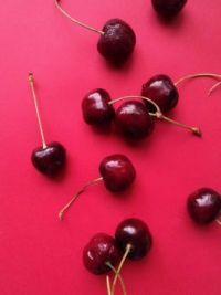 Cherries on a Red Background