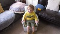 Piggly in his new chair!
