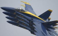Four Blue Angels in Tight Formation