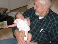 My husband holding niece's grandchild