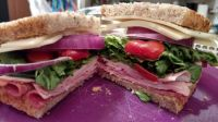 Ham, salami, Swiss, sweet lettuce and grape tomatoes on rye