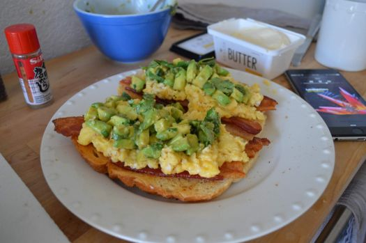 Ramsay-style creamy scrambled eggs & shichimi-guac on top of bacon & sourdough toast