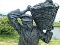 Statue 'the fisherman' in small village Havenhoofd