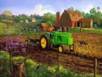spring farm and green tractor