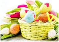 Easter Tulips and a Yellow Wicker Basket of Decorated Eggs