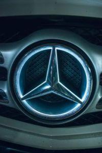 Mercedes Benz Logo Front Of A Car