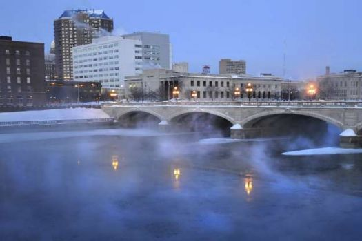 Steam rises above the Des Moines River in downtown Des Moines, Iowa, in 2010.
