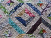 Strip-pieced quilt