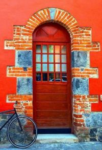 Bicycle at red door Portugal