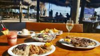 Monty's Raw Bar - Fish, Steak and Drinks under the Tiki Huts in Coconut Grove (Miami)