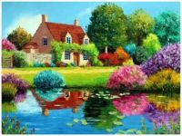 Beautiful Cottage with Flower Garden Reflected in a Pond