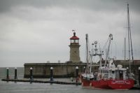 Lighthouse & harbour entrance England.