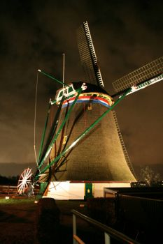 Lighted Dijkmolen(Dyke Mill) in Maasland, Netherlands.